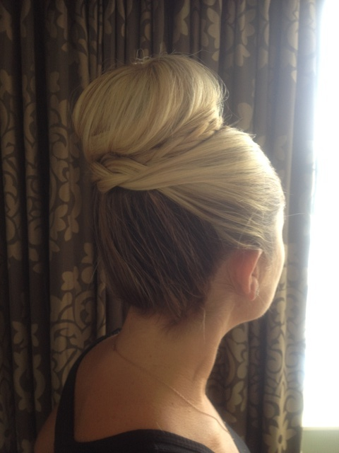Bridal updo with top knot and braid