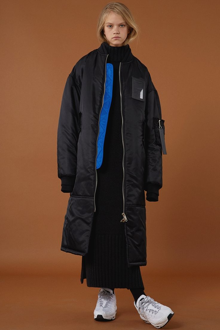 ADER error STORE streetwear black ladies bomber jacket and white trainers. Casual urban luxury