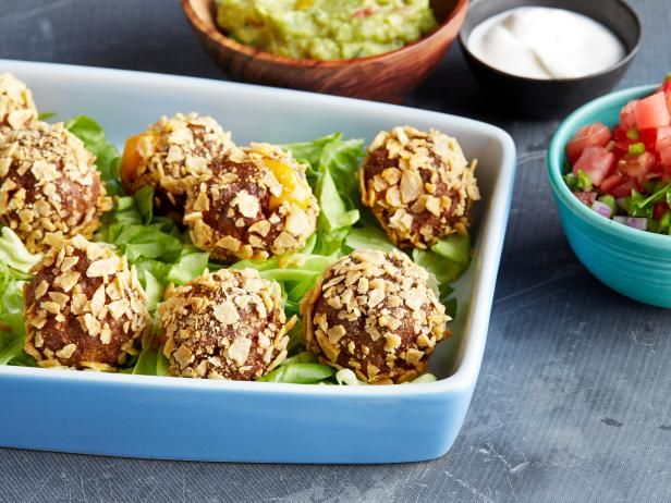 Get Food Network Kitchen's Cheesy Stuffed Taco Meatballs Recipe from Food Network