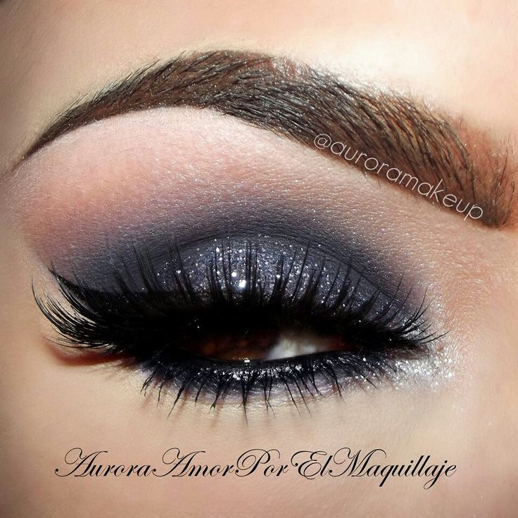Shimmery, midnight blue eyeshadow with winged liner & fake lashes.