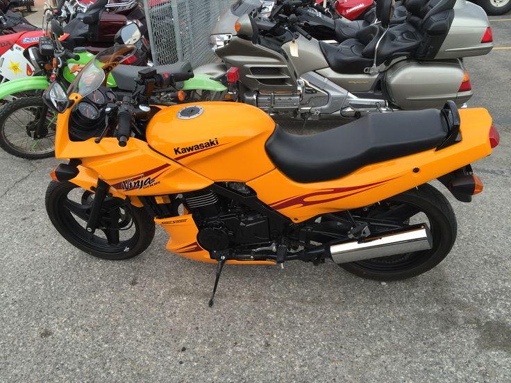 2007 Kawasaki NInja 500R aka EX500, in Solar Yellow (looks orange to me).