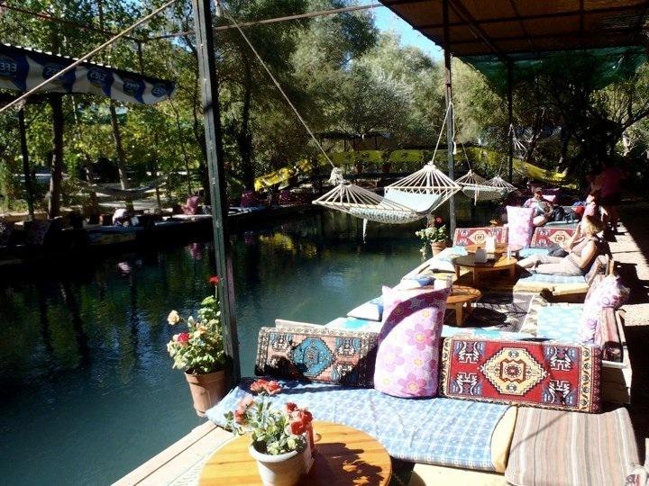 Hammocks and cozy pillows along the river running through Saklikent gorge/Fethiye/ in Turkey