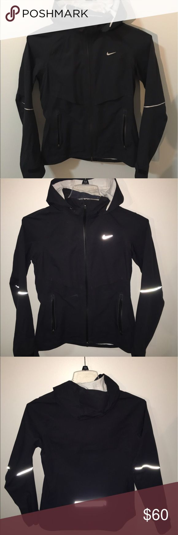 Nike running jacket ✨Nike running jacket✨ light weight running jacket with reflected details that are shown with the flash. It is water resistant but not a rain jacket. Please feel free to make an offer! Nike Jackets & Coats