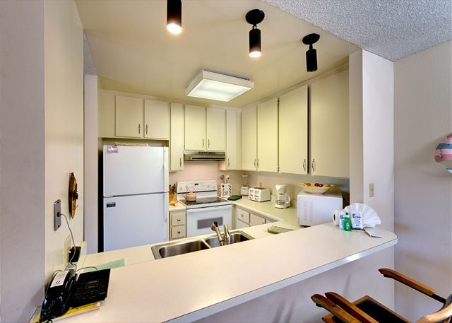 Lake Tahoe, California. Beautiful town home with white minimalist kitchen. Make your own meals and enjoy the lake view from the huge windows in the living room. Wake up to breathtaking scene each day of your stay!