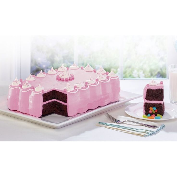 """Baker's Advantage Fillables 9"""" x 13"""" cake pan is a fun and unique way to add a surprise to your cake creations. The unique 2-piece design allows you to fill the inside of the cake with a variety of surprises including frosting, pudding, candies, chocolate chips and more. The scalloped shape provides cutting guides that ensure the filling will be contained within each individual slice of cake so everyone gets a surprise! The top side pan can be used as a traditional cake ..."""
