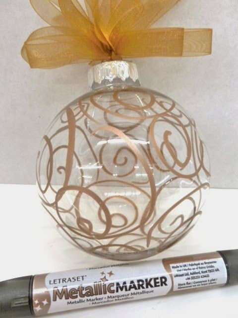 DIY Christmas Ornament made with a copper metallic marker/ Put your initial in scroll form, leaving space around the letter so it will stand out.