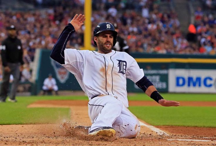 Emphatic point -        Detroit Tigers' J.D. Martinez scores on a single by Jose Iglesias off Chicago White Sox starting pitcher Jose Quintana during the fourth inning of a baseball game on June 26 in Detroit.   -    © Carlos Osorio/AP Photo