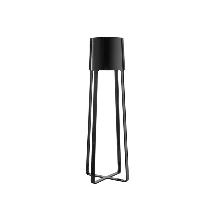 POULPE FLOOR LAMP  Imagine this sleek lacquered lamp had eight twisting arms instead of four straight legs (or simply translate its name from French), and the true muse for this fixture will be revealed.