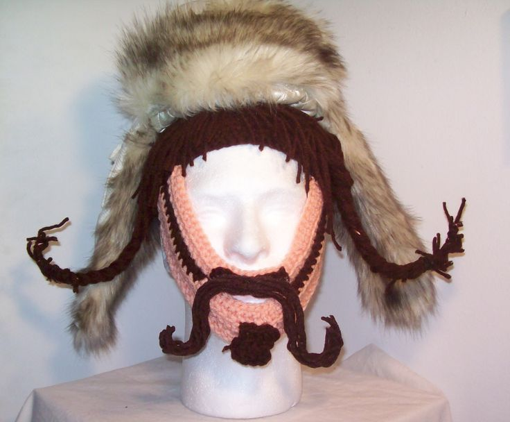 Bofur.  The braids have craft wire in them, and the mustache was formed separately with glue and let dry, then hot glue-gunned onto the upper lip crochet base.  You can't see it in this picture, but he's got another braid hanging down in the back.