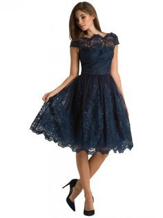 Stunning navy lace knee length scallop neck midi elegant dress. Perfect for an evening wedding guest outfit or could be brightened up with bold accessories and shoes. Gorgeous from Chi Chi London