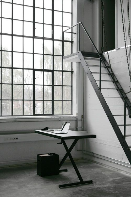 beautiful industrial big window + modern metal stars and desk. This would be such a cool studio