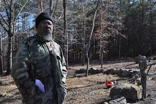 Mr. Robertson standing in front of his family cemetery    I recently visited a historic African-American cemetery and met with the cemet...