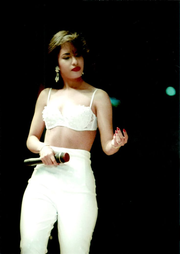 "the Late Selena. so beautiful. her look here looks so ""now"", with the embellished bra, high waisted pants, red bold lips."