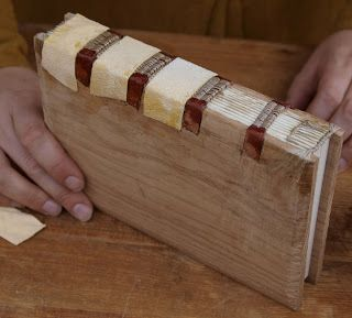 Leather strips and thread, book binding technique