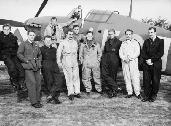 Squadron Leader Douglas Bader DSO (front centre) with some of the Canadian pilots of his Squadron, 242 (Canadian) Squadron, grouped around his Hurricane fighter aircraft at Duxford.