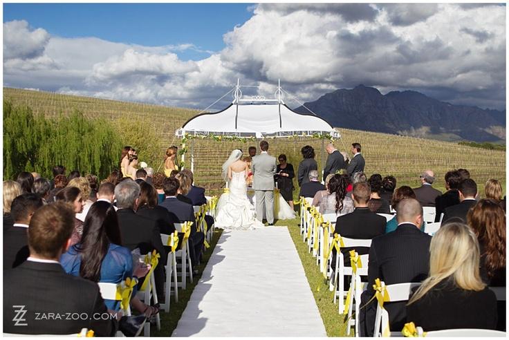 Outdoor wedding ceremony at Asara Wine Estate in Stellenbosch