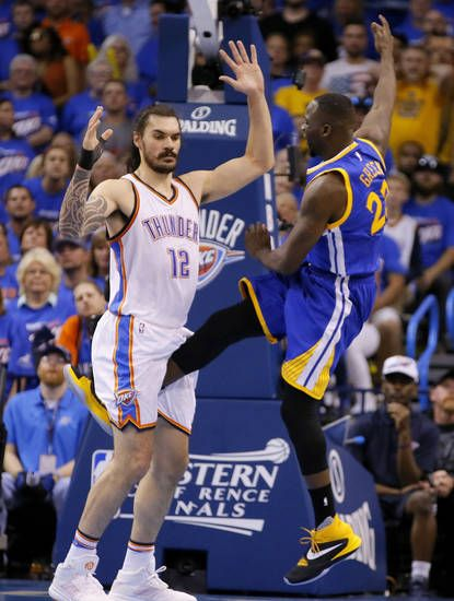 Golden State's Draymond Green (23) kicks Oklahoma City's Steven Adams (12) during Game 3 of the Western Conference finals in the NBA playoffs between the Oklahoma City Thunder and the Golden State Warriors at Chesapeake Energy Arena in Oklahoma City, Sunday, May 22, 2016. Photo by Bryan Terry, The Oklahoman