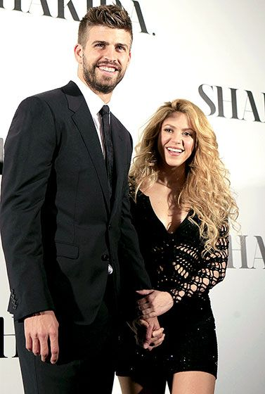 Shakira poses with boyfriend Gerard Pique -- father of her son Milan -- at the presentation of her new self-titled album in Barcelona on Mar. 20