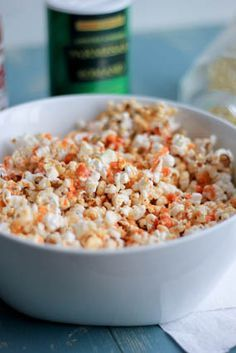 Buffalo Parmesan Popcorn  4 cups popped popcorn 2 Tbs. butter 2 Tbs. Frank's Red Hot Sauce 1/4 tsp. Cajun seasoning 1/2 tsp. salt 1/2 tsp. pepper 2 Tbs. Parmesan cheese