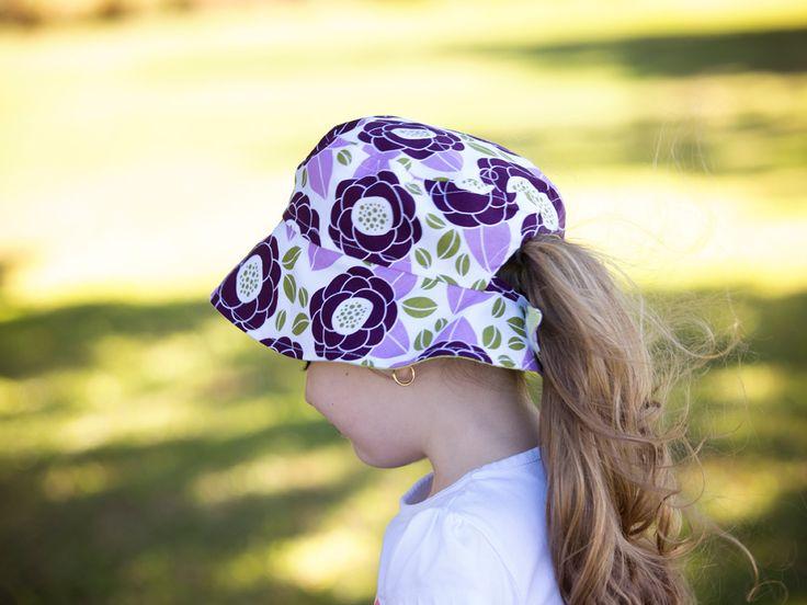 Reversible ponytail hat purple flowers