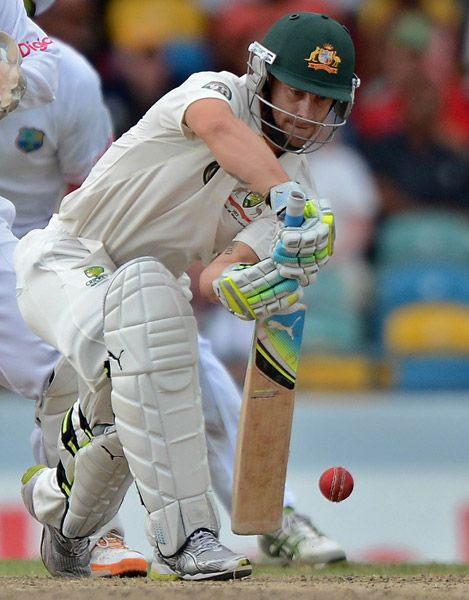 Australian cricketer Matthew Wade plays a shot during the third day of the first-of-three Test matches between Australia and West Indies at the Kensington Oval stadium in Bridgetown on April 9, 2012.