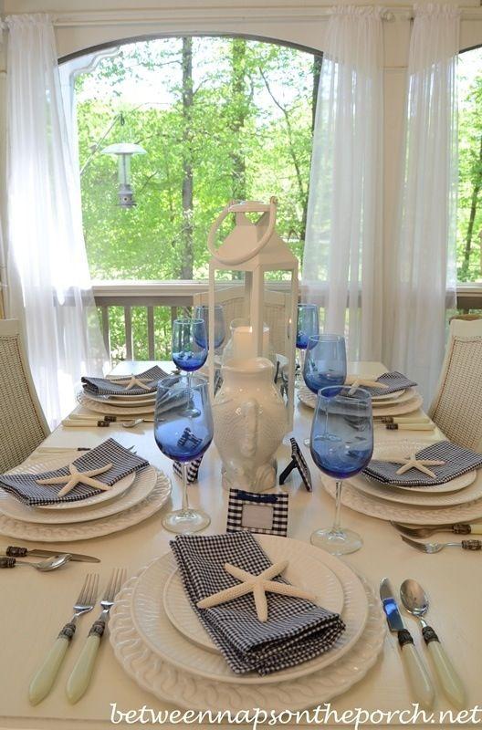 Coastal table setting. Blue white. White lantern