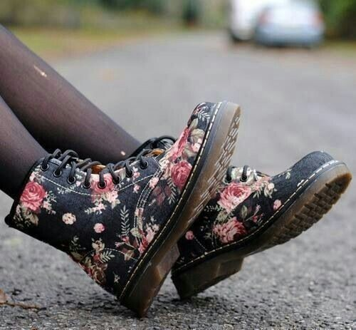 I'm so torn.  I need a new pair of combat boots (my last ones were crap and the zipper broke on the third or fourth wear) and I cant decide what I want.  I know I'm gonna get some Doc Martin's, though.  I heard they last forever!  Now, floral or solid?  Decisions, decisions...