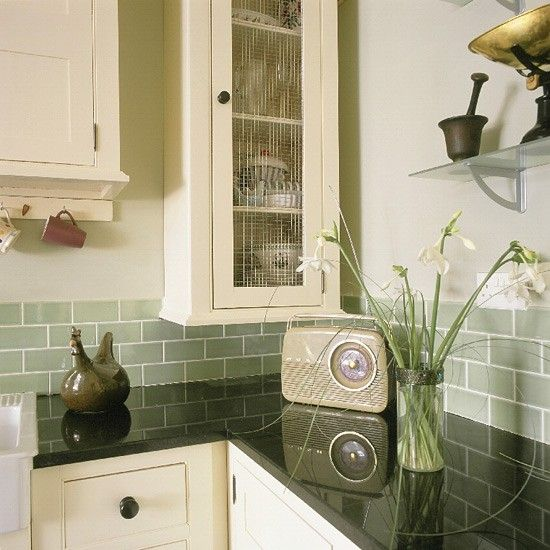 Cream Retro shaker-style kitchen - this also looks lovely - I know they like green also.