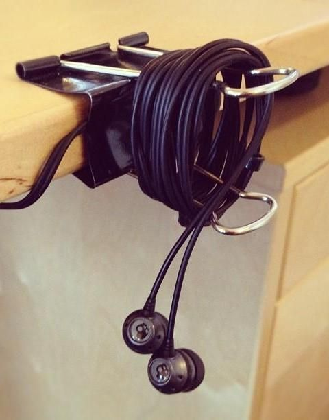 Keep your earbuds tidy at your desk with a binder clip.