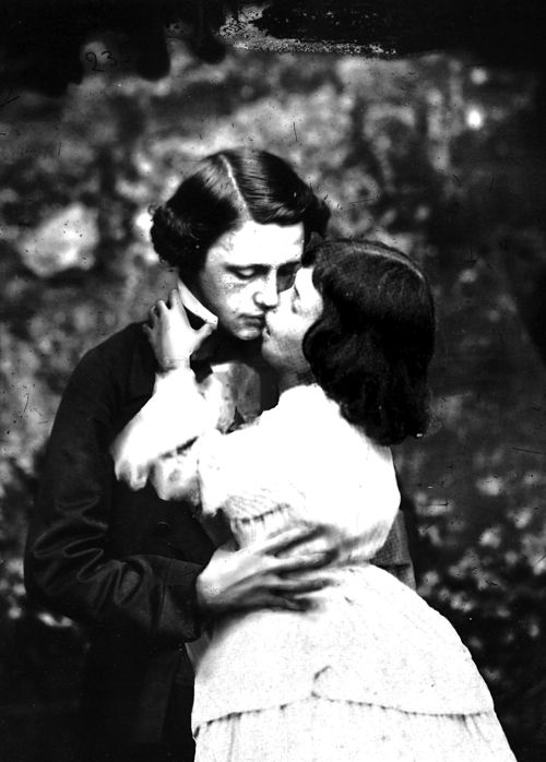 "Lewis Carroll kissing the real Alice.  Suspicion is confirmed.  I saw the play ""Peter and Alice"" in London and it dealt with the questionable relationships between the authors and the children they wrote about."