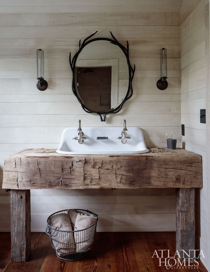 In an upstairs bathroom, Millner designed the trough vanity, which was fabricated on-site by the builder; the result is a look that's both primitive and edgy.
