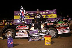Chris Ferguson holds the checker flag as he enjoys his victory at the 2016 Ultimate Super Model Series Championship at the Virginia Motor Speedway in Jamaica, Virginia.