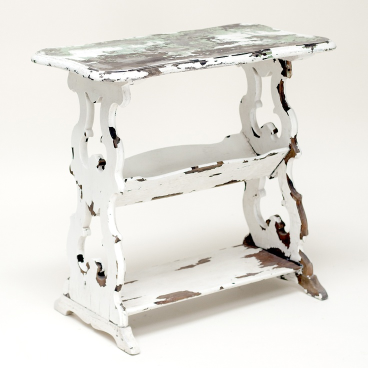 Kert side table: White chippy table.