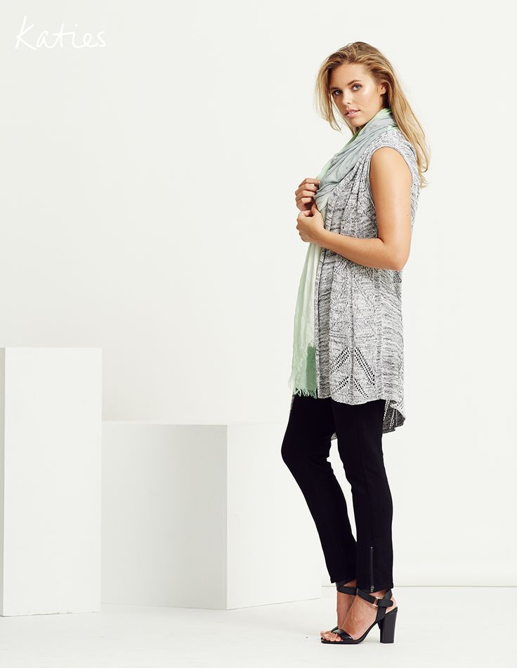 POINTELLE COVER-UP /  An easy wearing melange knit vest in the lightweight layering piece to wear now. Soft, drapey and chic, pair with a soft mint scarf and a smart black pant for an effortless go-ti-work look.