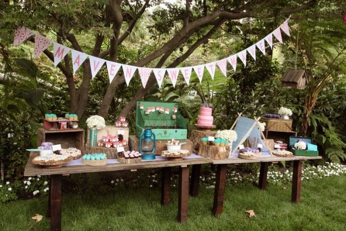 Absolutely fabulous everything....crates, picnic baskets, little tent, enamelware, tree stumps, etc.