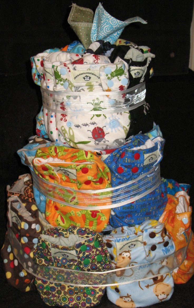 Cloth Diaper Cake for Baby Shower... Deluxe OS Cloth Diaper Cake Starter Set - 30 OS Pocket Diapers PLUS. via Etsy.