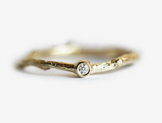 This is my idea of the perfect wedding ring. Small and inexpensive, but still classy and unique. Diamond Branch Ring Twig Ring Solitaire Diamond Ring by MinimalVS on Etsy.