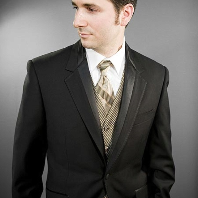 Black tux. Gold vest and tie. I want this for my wedding