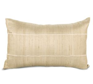 Add some interest with a lumbar shaped pillow.