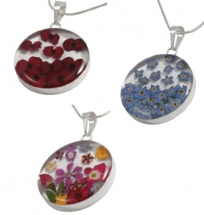 Blue Turtles Wildflowers - PENDANT- Large Circle  Item 1105831807    A moment in time... captured forever! Petals that look like they are delicately falling to land gently in this circlular pendant.    Handmade in Mexico, tiny wildflowers are preserved in resin and set in sterling silver.