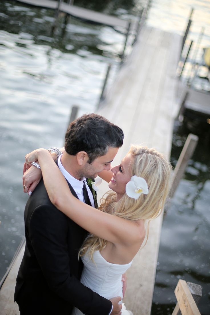 The Waterfront Event Center in Okoboji Iowa was lined with old docks making for some unique places to capture wedding pictures.