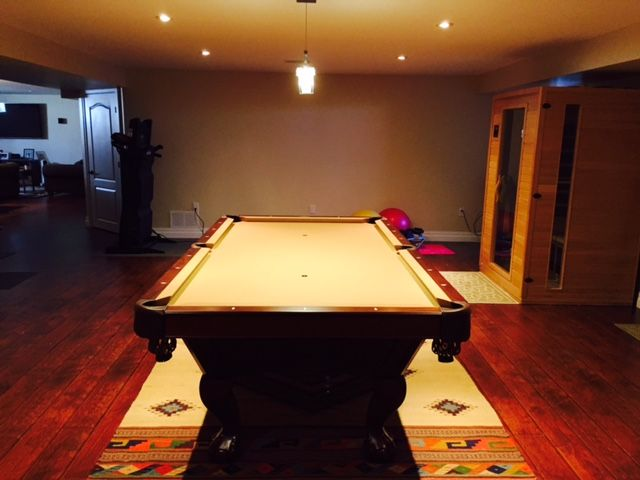 Brunswick Pool Table Allenton Chestnut Shown On An Area Rug