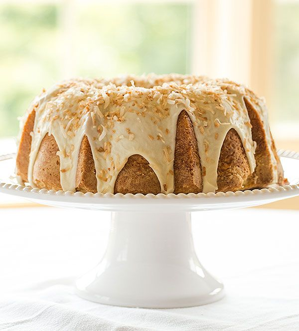 A wonderfully moist Coconut Bundt Cake recipe topped with a white chocolate-coconut glaze.