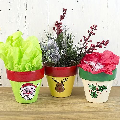 Create this project with Patio Paint Outdoor™ — Give a gift of plants in a threesome of terra cotta pots with holiday symbols of Patio Paint Outdoor™.