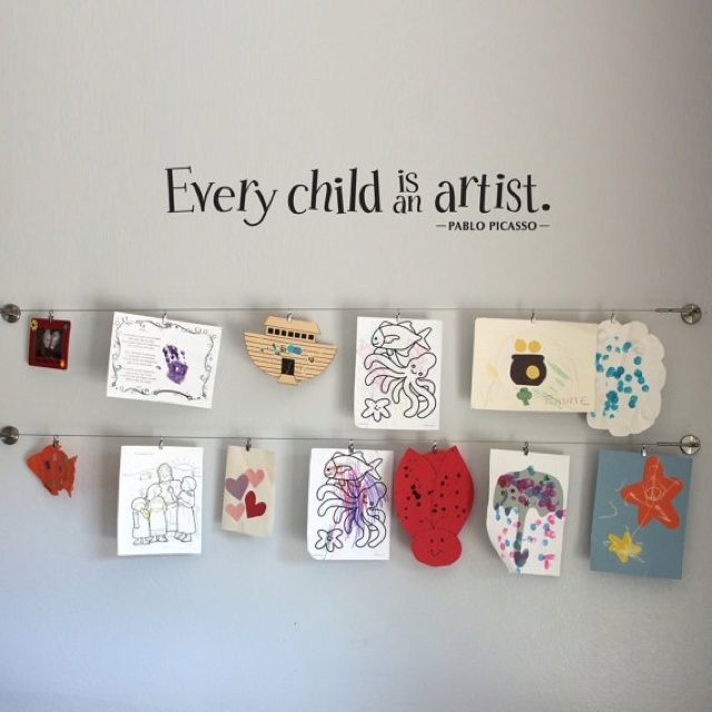 """""""every child is an artist"""" quote on kids artwork wall"""