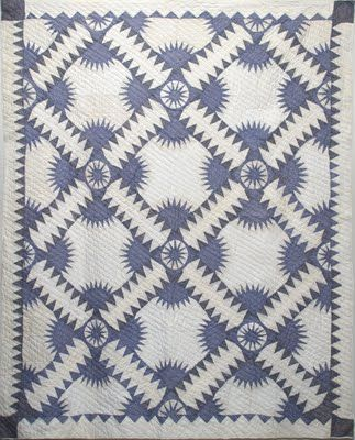 "Blue and white ""New York Beauty"" quilt made by Gertrude Barr of Nichols Hills, Oklahoma in the 1950's"