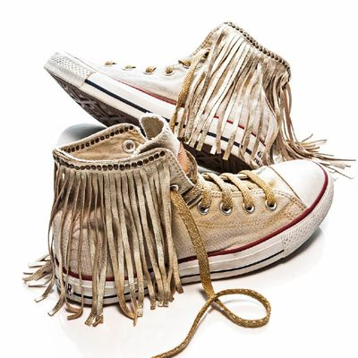 Where have these been all my life. Still wearing my black pair of converse from 8th grade. I love anything fringed!!