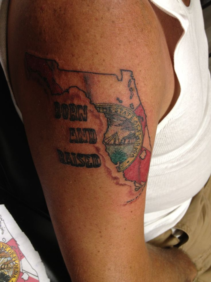 Florida tattoo with state flag waving was his first for South florida tattoo