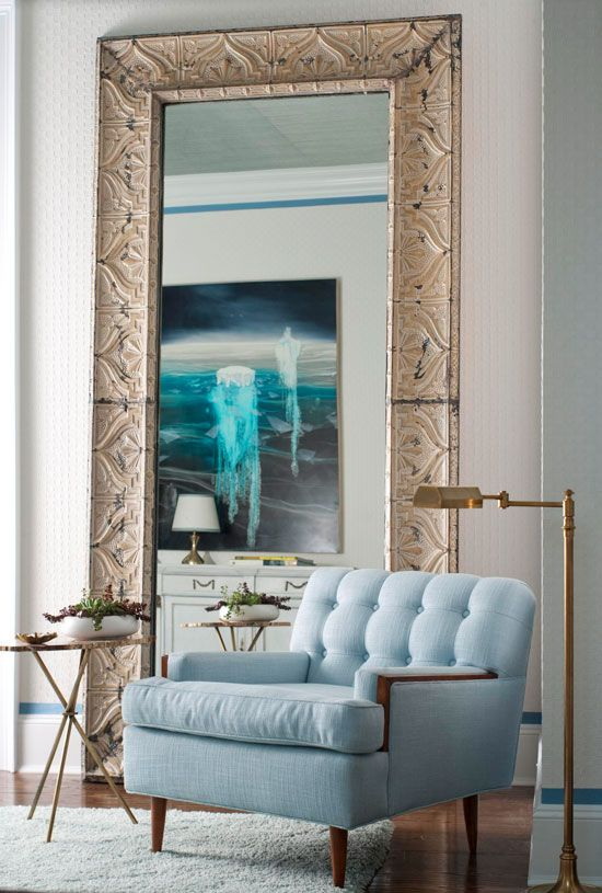 every home should have a one large floor mirror right love the impact of this metallic frame agains the cool blue chair