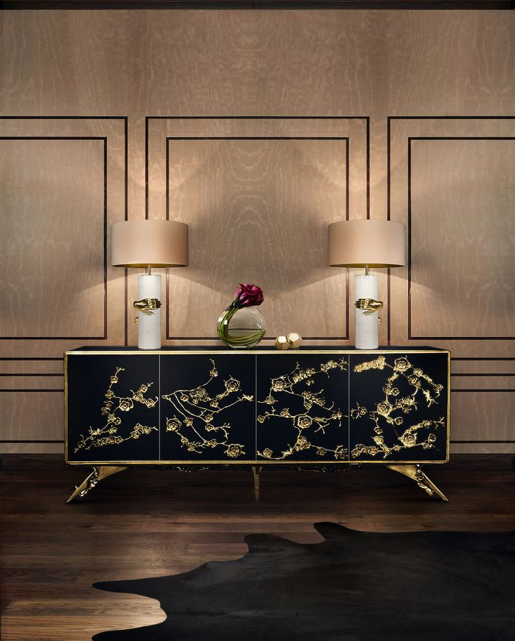 There is a sense of reveal & conceal as KOKET takes a beautiful chest form in high gloss black lacquer and adorns it in metal aged brass organic lace, revealing a mesmerizing hint of what lies beneath. Interior composed of 4 drawers embellished with organic work hardware in aged brass, finish to match exterior.